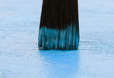 Brush cover the wood with bright blue paint Royalty Free Stock Photography