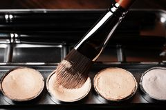 Brush and cream concealer. Professional cosmetic. Cream concealer. Stock Images