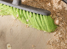 With a brush for dust cleaning close-up. In the shop, sawdust stock photos