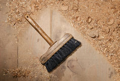 With a brush for dust cleaning close-up. In the shop, sawdust royalty free stock photo