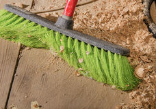 With a brush for dust cleaning close-up. In the shop, sawdust Royalty Free Stock Image
