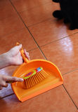 Brush and dustpan in the hands Royalty Free Stock Photos
