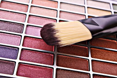 Brush and eye shadows Royalty Free Stock Images