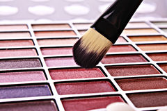 Brush and eye shadows. Closeup Brush and eye shadows Royalty Free Stock Photography