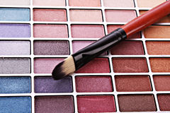 Brush and eye shadows Stock Photos