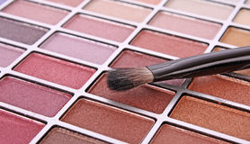 Brush and eye shadows Stock Photos