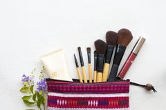Beauty skin face cosmetic makeup for colorful woman. Brush ,eyes shadow ,lipstick ,sunscreen spf50 beauty skin face cosmetics makeup for colorful woman on white stock image