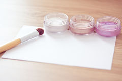 Brush and eyeshadow/watercolor with empty card Royalty Free Stock Photography