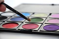 Brush and eyeshadows Stock Photo