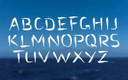 Brush Font Bold Letters on Sea Background. Vector Font. Brush strokes bold type. Grunge ABC on sea background. Painted letters design Stock Photos