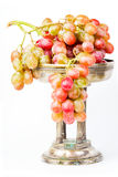 Brush fresh grapes in the old antique vase Stock Photo