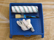 Brush, gloves, roller and paint tray Stock Photo