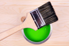 Brush and green paint bucket Stock Photography
