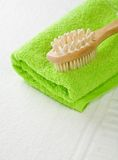 Brush on green towel Stock Image