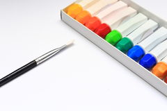 A brush and a group of water color for painting Stock Image