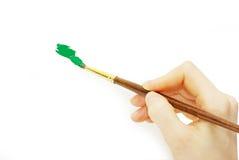 Brush in hand Stock Photo