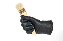 Brush in a hand Stock Images