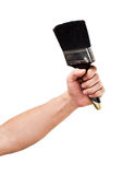 Brush in hand isolated Stock Images