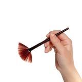 Brush in hand Royalty Free Stock Photo