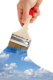 Brush in hand paints the sky Stock Photos