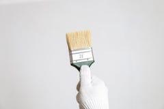 brush handen Arkivbilder