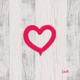 Brush heart shape on wood. Royalty Free Stock Photography