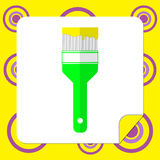 The brush icon to paint with a drop of yellow paint. Stock Photography