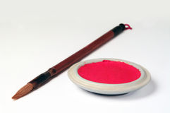 Brush and Ink. Chinese calligraphy brush and red ink stock images
