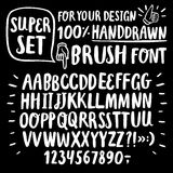 Brush ink  ABC letters set. Hand drawn brush ink  ABC letters set on black background. Hand drawn doodle comic font for your design Stock Photography