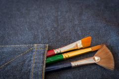 Brush and Jeans. Concept art Brush and Jeans Royalty Free Stock Photography