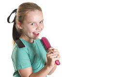 Brush Karaoke. Young girl pretending that her hairbrush is a micro-phone and singing Royalty Free Stock Images