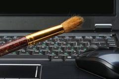 Brush and a laptop Stock Photos