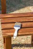 Brush laying on wooden boards of a chair to painting wood preser. Vative paint stock images