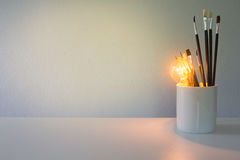 Brush and light bulb Stock Photo