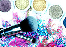 Brush, Lipstick, and Makeup Shadows Stock Photography