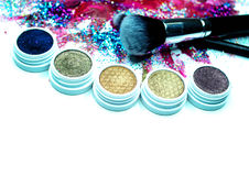 Brush, Lipstick, and Makeup Shadows Royalty Free Stock Image