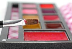 Brush Loaded with Lip Gloss Royalty Free Stock Photos