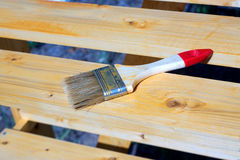 Brush lying on a painted wooden shelving surface Stock Image