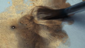 Brush macro mixes the paint on the paper palette - liquid gold. Artist, creativity, drawing stock video footage