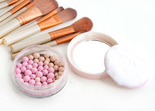Brush for make-up with powder balls. Stock Photography