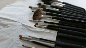 Brush make-up on the table. Makeup artist takes the brush stock video