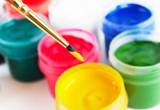 Brush and many paint jars with colored gouache Stock Photos