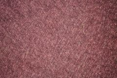 Scratchy Texture in Maroon. A brush metal surface with a maroon red color for awesome backgrounds royalty free stock photo