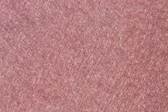 Scratchy Texture in Maroon. A brush metal surface with a maroon red color for awesome backgrounds stock photography