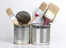 Brush in metal tins Royalty Free Stock Photos