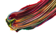 Brush mixing paint. Red, yellow, blue, green, white Royalty Free Stock Images