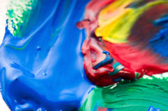 Brush mixing paint on palette Stock Photos