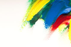 Brush mixing paint on palette Stock Images