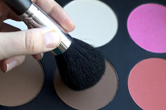 Brush near a cosmetic palette Stock Photography