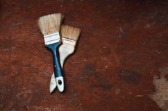 Brush on old table. Two brushes lay on the table with a rough textured old Stock Images